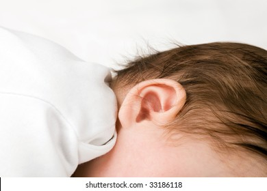 Photo of a babie's ear, isolated on white