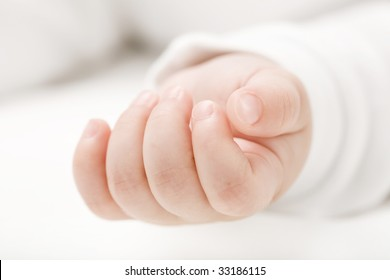 Photo of a babie's hand lying relaxed