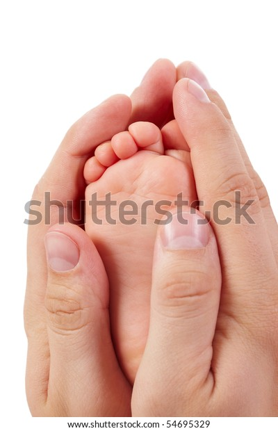 Photo of baby foot between father?s palms isolated on white background