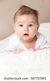 Photo of Baby girl  lying on bed