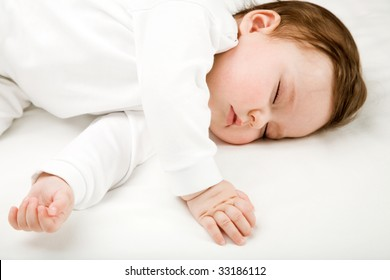 Photo of a baby, sleeping, isolated on white