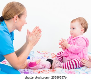 Photo of babysitter playing with an adorable baby
