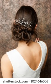 Photo from back of girl with hairdo and diadem