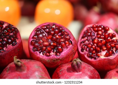 Photo background bright macro beautiful red pomegranate cut on the counter