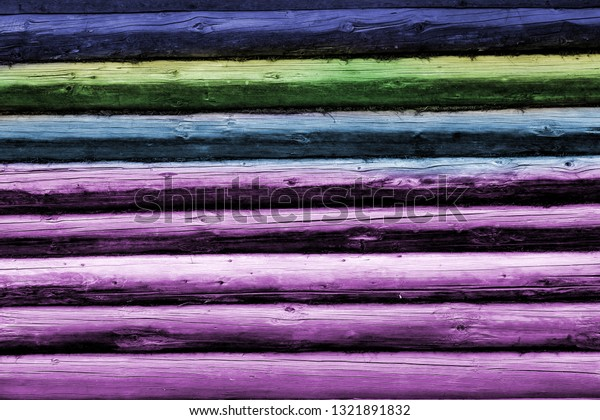 Photo background of retro masonry lumber wood wall facade of a hut in the village