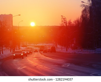 Photo background of a road driving with cars at sunset in winter