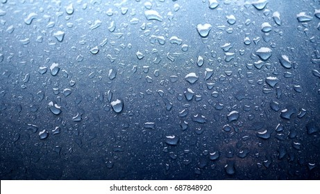Photo background with waterdrops on gradient blue surface. Blue waterdrops wallpaper.