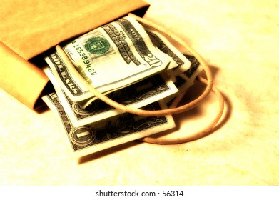 Photo of a Bag and Money With Color and Blur Effect.