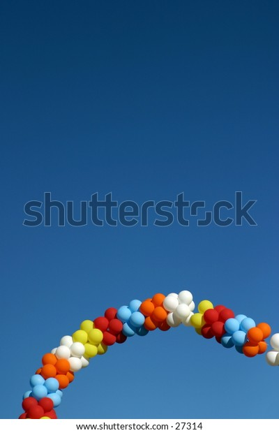 Photo of balloons in the air on a blue sky background.