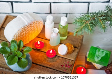 Photo of bathrooms, spa treatments. Transparent bottles, loofah, pieces of soap, bath salts, candles. Comfort and relaxation