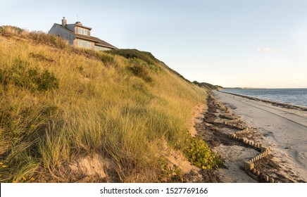 Photo of the bay (beach) in North Truro (Cape Cod) Massachusetts with a house in the distance.