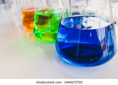 Photo of beakers, tubes and other instruments in laboratory using for experiment and reaearch. Photo concept of biochemistry, microbiology, and phamaceutical. Selective focus.