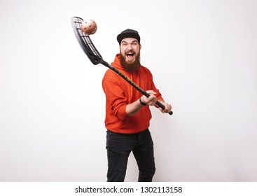 Photo of bearded man floorball, showing his skills, and enjoy it over white background