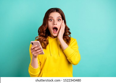 Photo of beautiful attractive charming cheerful nice cute pretty sweet young girl shocked with new information about sales wearing yellow sweater isolated over vivid color bright background