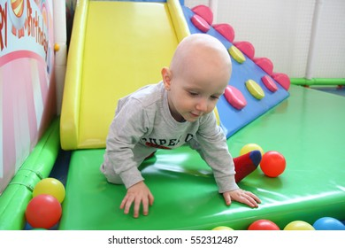 Photo of the Beautiful baby boy playing at playland