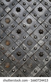 Photo of a beautiful background of a metal door with an ornament