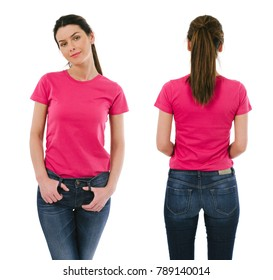 Photo of a beautiful brunette woman posing with a blank pink t-shirt, ready for your artwork or design.