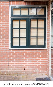 photo of beautiful cool windows with jalousie on one of buildings