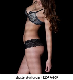 Photo of beautiful female body in sexy lingerie on a dark background