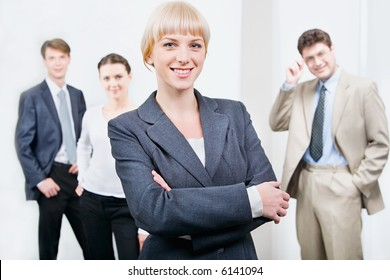Photo of beautiful female leader on the background of her business team