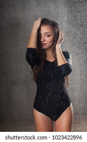 photo of a beautiful girl who wet in the rain on a dark background