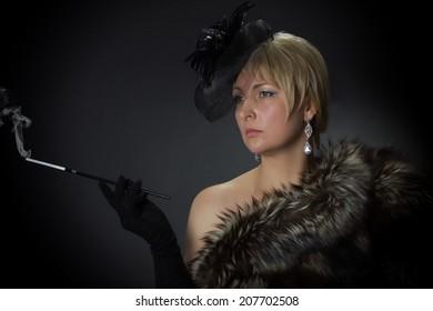 photo beautiful glamorous woman in the studio