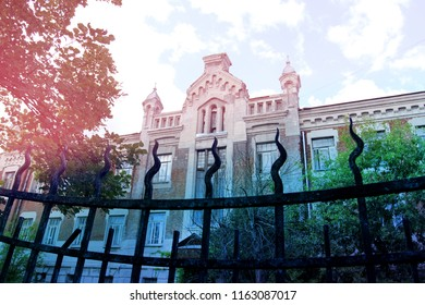 Photo of a beautiful gothic building and fence in Russia