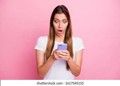 Photo of beautiful lady holding telephone hands read awful bad news not believe eyes open mouth see unfollowers wear casual white t-shirt isolated pink color background