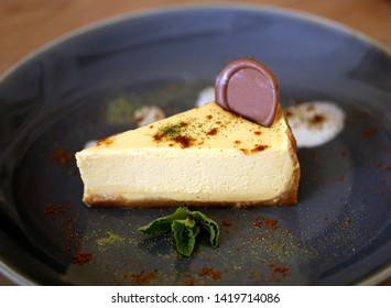 Photo of beautiful macro sweet chocolate cake cheesecake with chocolate in a restaurant
