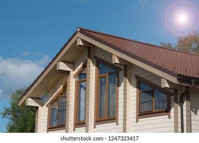 Photo of beautiful modern wooden house and sunshine lights.