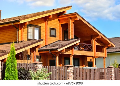 Photo of beautiful modern wooden house.