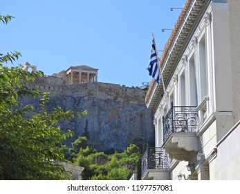 Photo of beautiful neoclassical houses in iconic district of Anafiotika in the slopes of Acropolis hill, Athens historic center, Attica, Greece