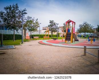 A photo of a beautiful park with a playground for kids located at the entrance of the touristic town El Palmar. This town is famous in Valencia for its restaurants and boat trips around the Albufera.
