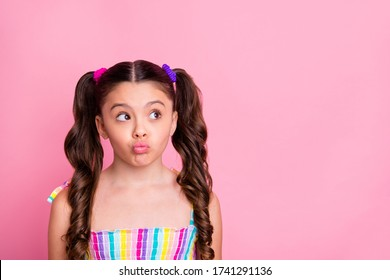 Photo of beautiful pretty funny little lady two cute curly tails look interested side empty space send air kisses shy girl wear colored dress summer singlet isolated pink color background