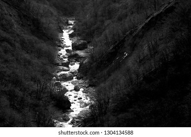 Photo of a beautiful river among a large gorge in the mountains