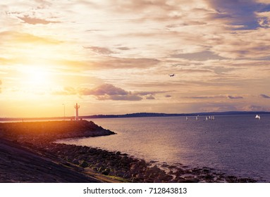 Photo of a beautiful scenic sea landscape. Yachts in sea, view on Howth Harbour Lighthouse, Howth Peninsula, county Dublin, Ireland. Lightly toned