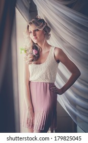 Photo of beautiful sensual woman in romantic pink dress. Photo processed instagram style.
