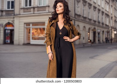 Photo of beautiful stylish brunette woman in the city ,wearing nice long coat. Fashion fall autumn spring photo