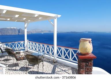 Photo of beautiful white patio over the sea, Oia Village, Greece