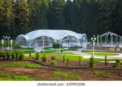 Photo of the beautiful white wedding veranda among forest
