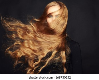 Photo of beautiful woman with magnificent hair. Perfect makeup. Fashion photo