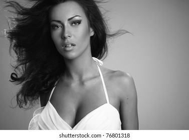 Photo of beautiful woman with magnificent hair. Black-white Photo.