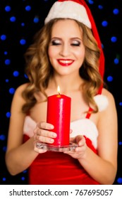 photo of Beautiful woman in Santa dress with candle