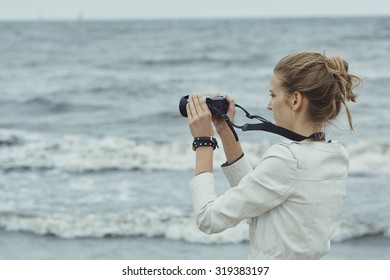 photo of beautiful youn girl with camera
