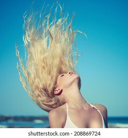 Photo of beautiful young blonde at blue sea