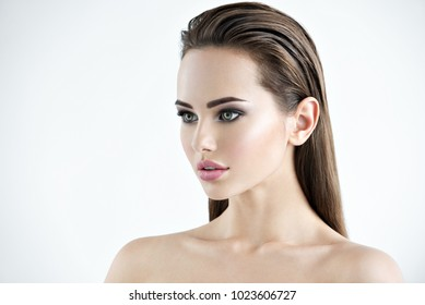 Photo of a beautiful young girl with beauty face  - isolated on white.  Skin care concept. Profile portrait of an attractive woman with clean skin