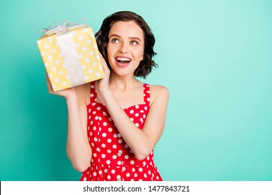 Photo of beautifully looking charming nice attractive woman intending to gift someone this box with unknown stuff inside while isolated with teal background