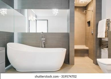 Photo of big new design bathtub in spacious trendy bathroom