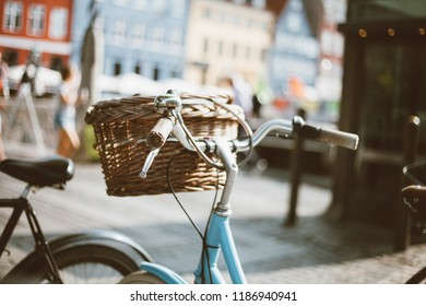 Photo of bikes with whiskets at Copenhagen streets.Copenhagen bicycles which has a whisket in front of the colorful buildings at Nyhavn.