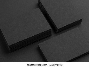 Photo of black business cards. Dark template isolated on black background. For graphic designers presentations and portfolios. Business card mock-up black on black.